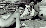 19 Jean Cocteau & Jean Marais, beaching,